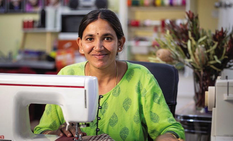 Female Paw Po Products staff member sewing