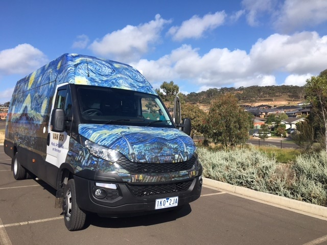 The Van Go mobile therapy bus parked on the side of the road in rural Victoria.