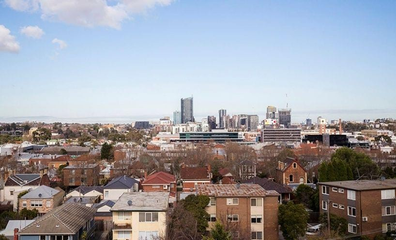 City skyline with suburban housing in foreground