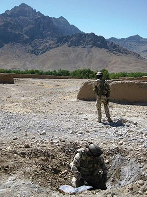 Weapons Intelligence Team conducting post blast exploration of IED blast site in Baluchi Valley, 9 September 2009.